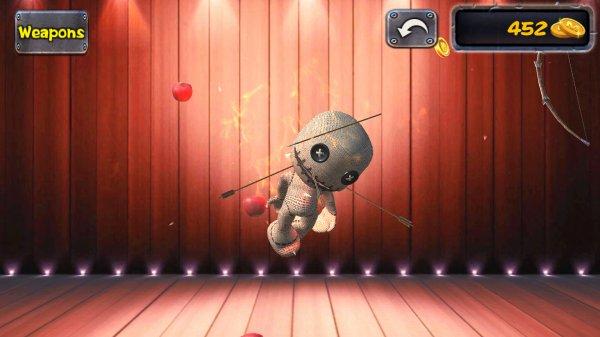 弓矢とりんごで攻撃される人形